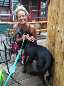 """Kelli is a Big Island Brewhaus server and LOVES dogs. Pepper is telling her """"Mahalo!"""" for letting him join us for lunch."""